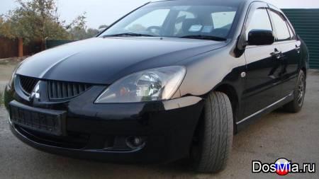 Мицубиси лансер в хорошем состоянии, черный, 2005 г. в., двигатель 1,6 л.